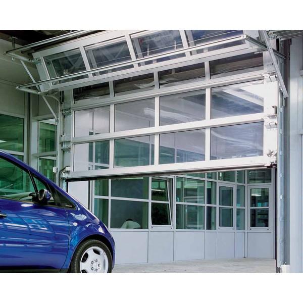 Белые складные ворота промышленного назначения с панорамным остеклением