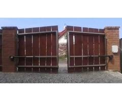 Распашные ворота с приводом FAAC для дома загородного
