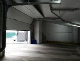 Секционные ворота с приводом FAAC для парковки